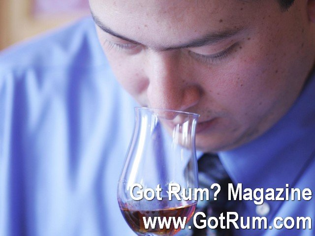 Luis Ayala close up with snifter of rum