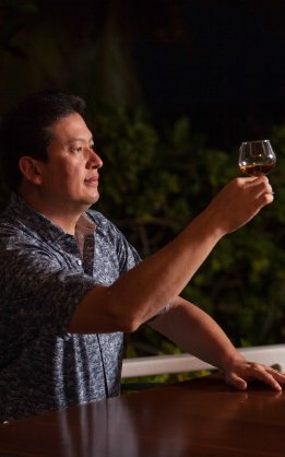 Luis Ayala holding a snifter of rum