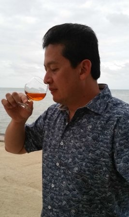 Luis Ayala with snifter in Belize