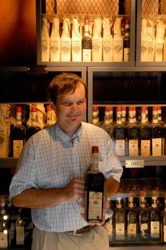 Marc Sassier holding a bottle of Saint James Rhum