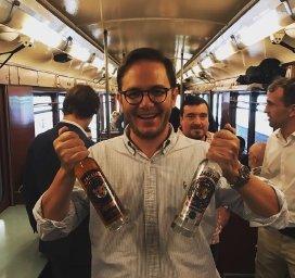 Edgar Sanchez Wilke holding rum bottles