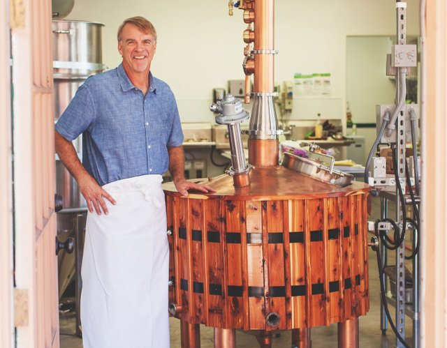 Eric Olson in his distillery.jpg