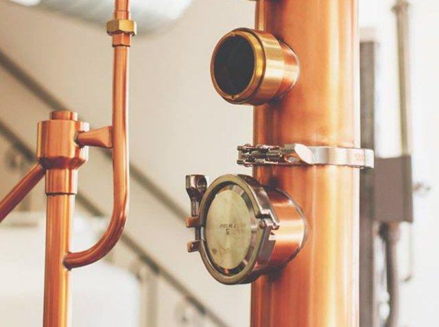 Eric W. Olson Distiller