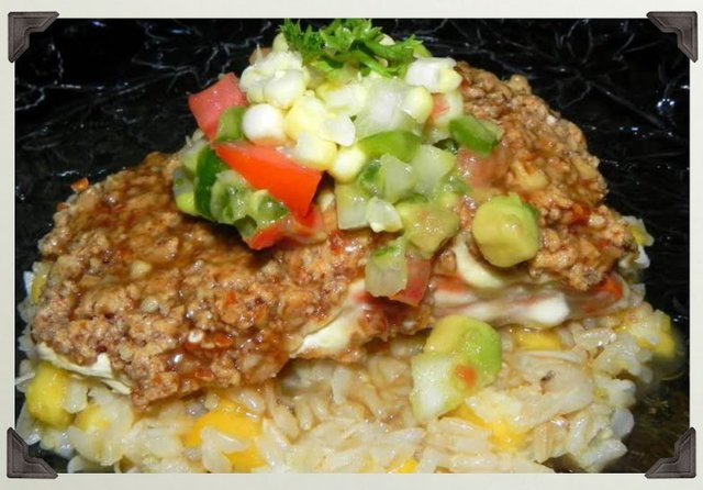 Nutty Crusted Salmon w with Coconut Rum Sauce over a bed of Peachy Coconut Rice topped with fresh Pico de Gallo