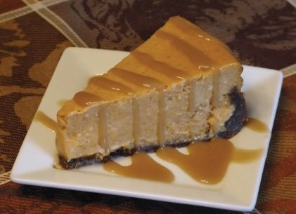Pumpkin Cheesecake with Rum Sauce